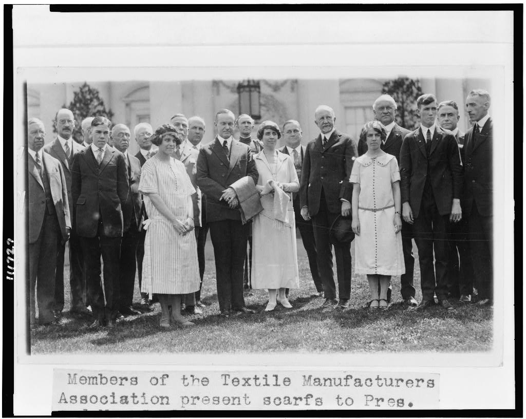 Members of the Textile Manufacturers Association presenting scarfs to the Coolidges on the White House lawn, 1925. Courtesy of the Library of Congress.