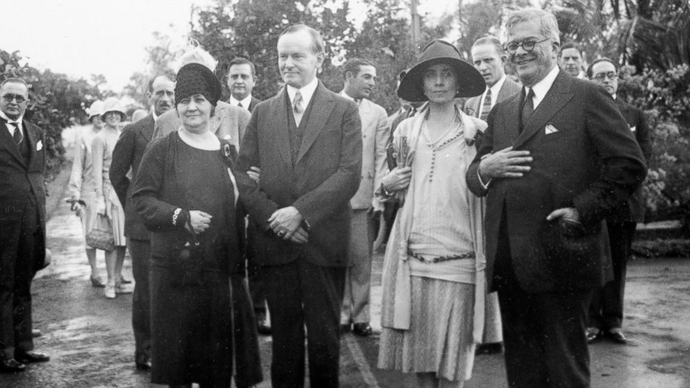 President and Mrs. Coolidge, visit the estate of Cuba's president at the time, General Gerardo Machado y Morales, whose wife, Elvira, stands to Coolidge's right, January 19, 1928. Courtesy of the Associated Press.