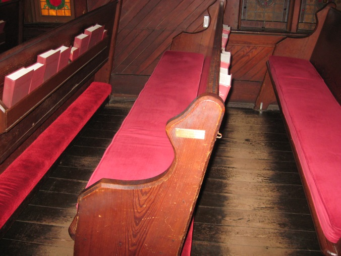 The Coolidge Pew, where the President and Mrs. Coolidge sat during the services. The plaque is mismarked, dating the service on a Monday instead of Sunday, December 30.