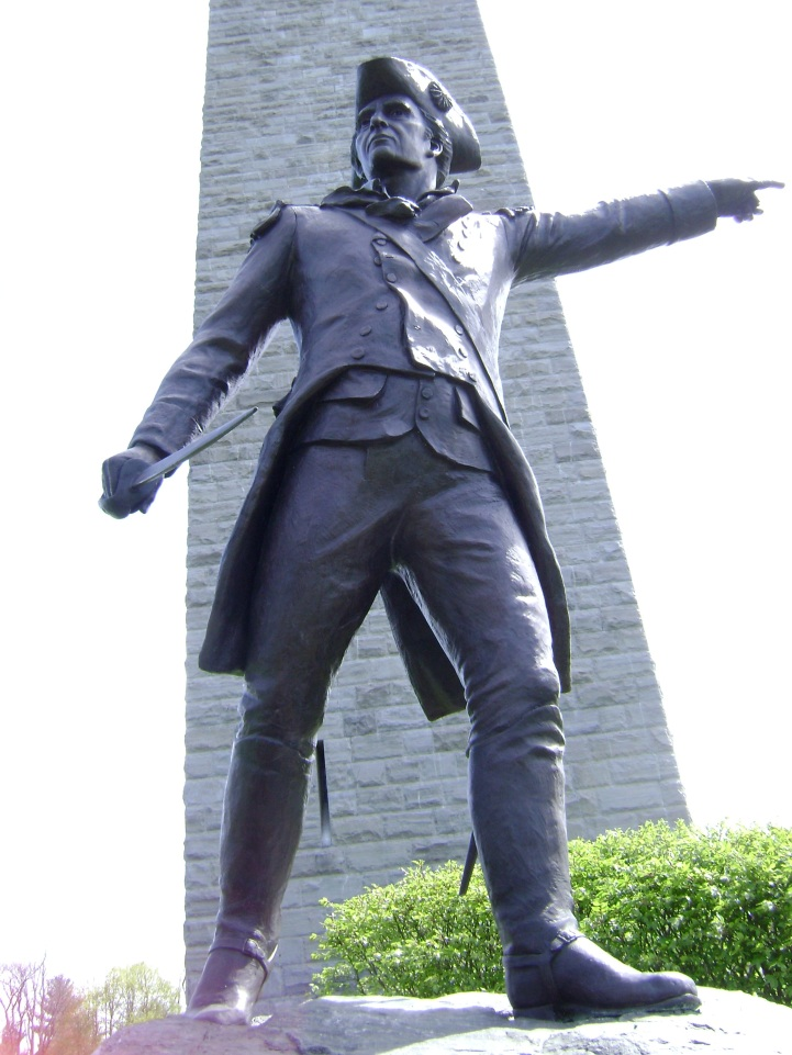 Colonel Stark's statue at Bennington. Declining the offers of friends to attend the commemorative ceremonies of the Battle in 1809, Stark, at age 81, would close his letter with what would become his native state, New Hampshire's motto: 'Live free or die; Death is not the worst of evils.' It was here at the battle's obelisk Monument that Coolidge saw and heard his first President, Benjamin Harrison, in 1891.
