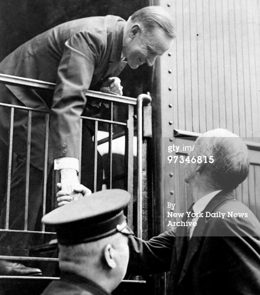 Coolidge shaking hands with a fellow citizen, as he boards a train for New York, February 3, 1924. Courtesy of Getty Images.