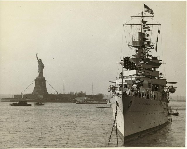 """USS Indianapolis (CA-35), was laid down in Camden, New Jersey on 31 March 1930, launched in November the following year and commissioned in Philadelphia Navy Yard, 1932. She distinguished herself early as the President's flagship for his """"Good Neighbor"""" cruise of Central and South America. Indianapolis would become the flagship of the prestigious Fifth Fleet. Engaged in simulated bombing exercises to the southwest of the Hawaiian Islands when Pearl Harbor was attacked, she immediately joined in the hunt for the Japanese carriers responsible. She would go on to take the fight to the enemy, going deep into hostile waters more than once during the war, supporting amphibious landings from Tarawa to Saipan, shooting down an enemy plane at the Battle of Philippine Sea, participating in the first attack on Tokyo since Doolittle's raids, serving as support for the landings at Iwo Jima, shelling beach defenses for seven straight days, shooting down six planes and helping to splash two others. Her final mission was the delivery of nuclear materials to be used on Hiroshima and Nagasaki, racing five thousand miles in ten days from San Francisco to Tinian. Hit by two torpedoes upon her return, she was torn open and sank in twelve minutes on 30 July 1945. The crew drifted two days in open ocean before finally being discovered by random patrols on 2 August, clinging to life, fending off sharks and waiting for rescue. Tragically, only 316 were recovered from a total count of 1,199. Despite her misfortune, she stands among the greatest of the Coolidge cruisers for her fortitude and perseverance."""