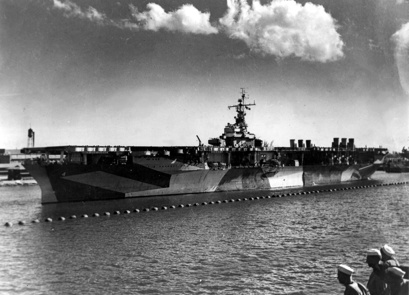 USS Ranger (CV-4), named for the famous sloop that had been the first ship flying the American flag to be saluted back in 1778, CV-4 was the first built from the keel up as a carrier. In a real sense, Coolidge made this essential component of America's navy possible when he approved the Cruiser Act. Laid down on 26 September 1931 in Newport News, Virginia, Ranger would be launched two years later and commissioned in 1934. She was returning from patrols in the Caribbean when the Japanese attacked Pearl Harbor. The largest carrier in the Atlantic Fleet at that time, she led the amphibious assault on French Morocco in 1942, launching 496 sorties over three days, forcing the enemy to capitulate before Allied pressure. Returning to home coasts, she patrolled the Atlantic seaboard until joined to the British Home Fleet, protecting the approaches to those islands. Taking the offensive to Germany's back door, she waged war in Norwegian waters, successfully targeting convoys, tankers, merchant ships and transports. Winding down her wartime service, Ranger carried planes to Casablanca then personnel to the Pacific and finally brought essential training to both air and sea units operating out of the west coast. Working her way back to the east coast, she retired from the service over a year after the end of the war, October 1946.