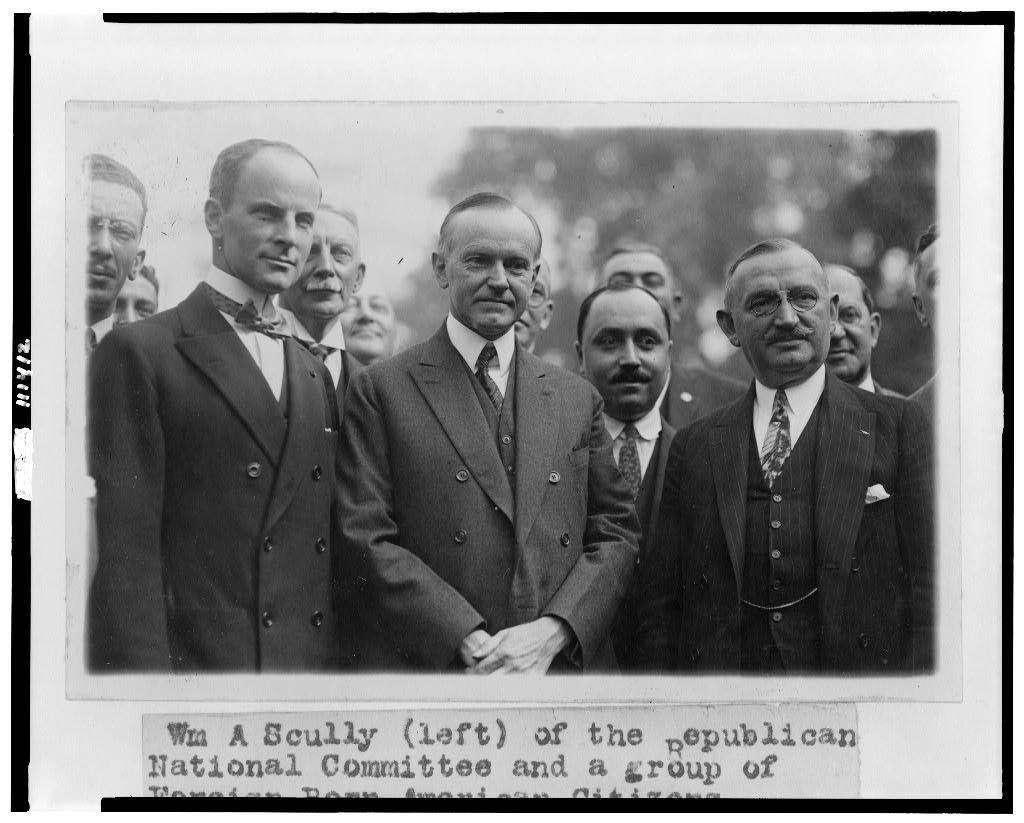 Calvin Coolidge with a gathering of newly naturalized Americans, hosted by William Scully of the Republican National Committee, 1924.