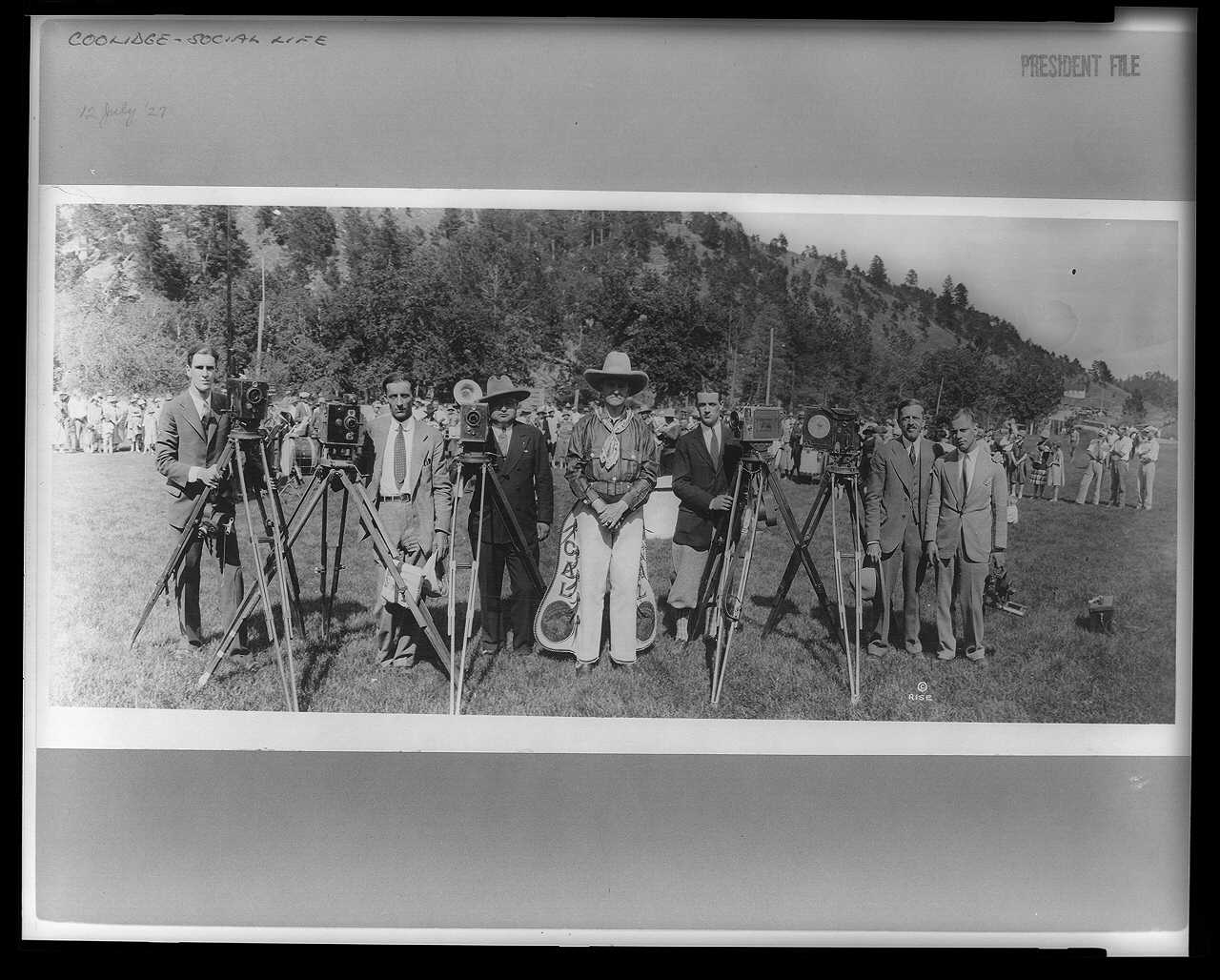 President Coolidge posing in his new gear with photographers, near the Game Lodge in Custer State Park, South Dakota.