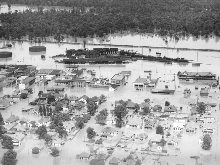 Flood damage in McGehee, Arkansas, May 1927. See http://kaiology.wordpress.com/2011/08/13/coolidge-and-the-1927-mississippi-flood/.