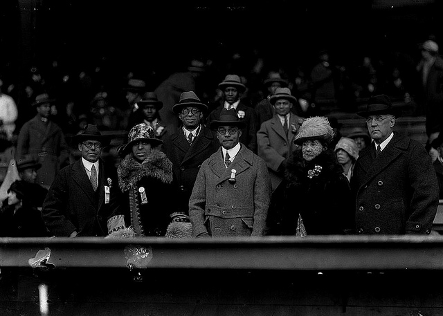 Judge James A. Cobb, appointed by Coolidge to the bench, watches a Howard University football game with friends, 1930.