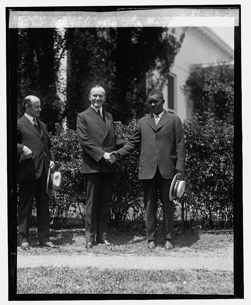 President Coolidge visits with Mr. Thomas Lee at the White House, May 28, 1925. Mr. Lee was recognized for his heroic efforts rescuing those endangered when a steam vessel capsized suddenly on the Mississippi River. Courtesy of the Library of Congress.