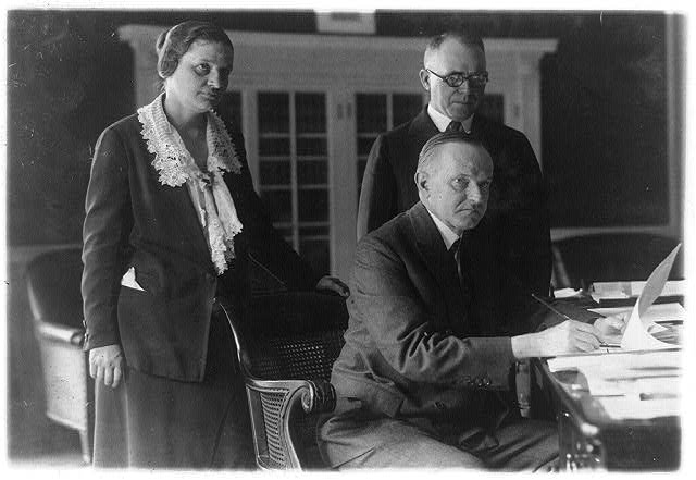 President Coolidge collaborating with Assistant Attorney General Mabel Willebrandt and Representative Israel M. Foster on child labor and education policy, June 7, 1924. Courtesy of the Library of Congress.