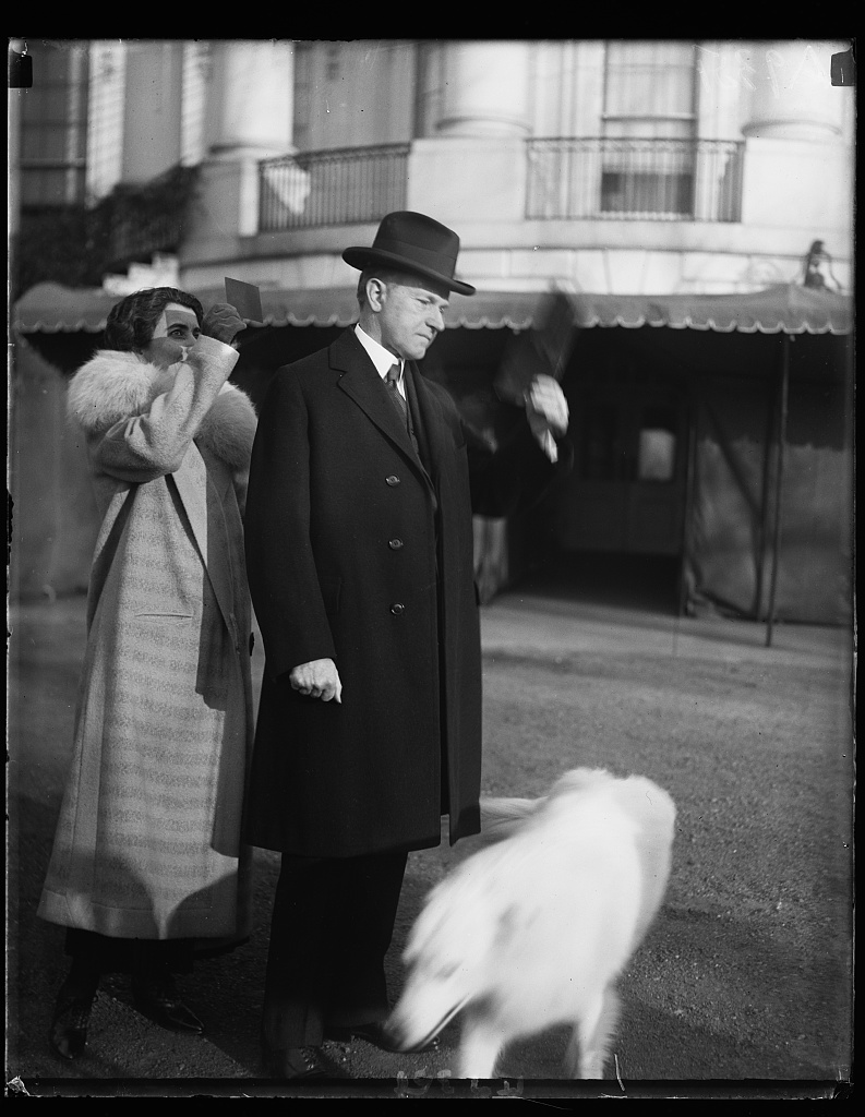 President and Mrs. Coolidge with Rob Roy venture out in the early morning, despite freezing temps, to see the solar eclipse on January 24, 1925, seen from the lawn of the White House. Courtesy of the Library of Congress.