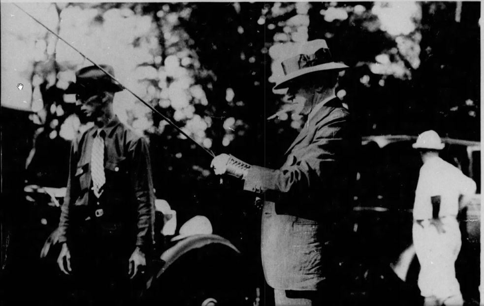 Coolidge preparing for trout, July 19, 1929.