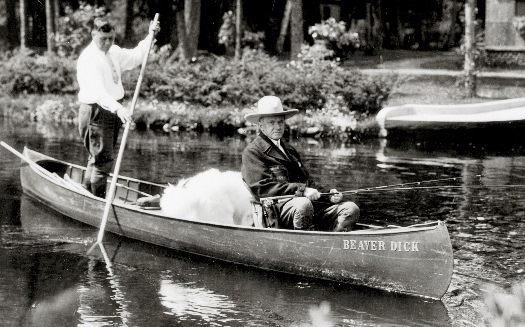 Coolidge, his dog Rob Roy, and his Brule River guide, John LaRock, 1928.