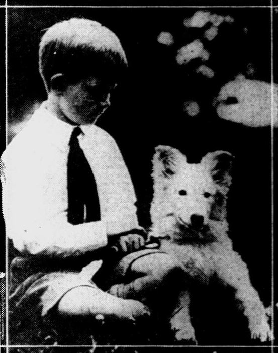 Robert Scripps posing with Diana/Calamity Jane in Rapid City, as they present the dog to the President, July 1927.