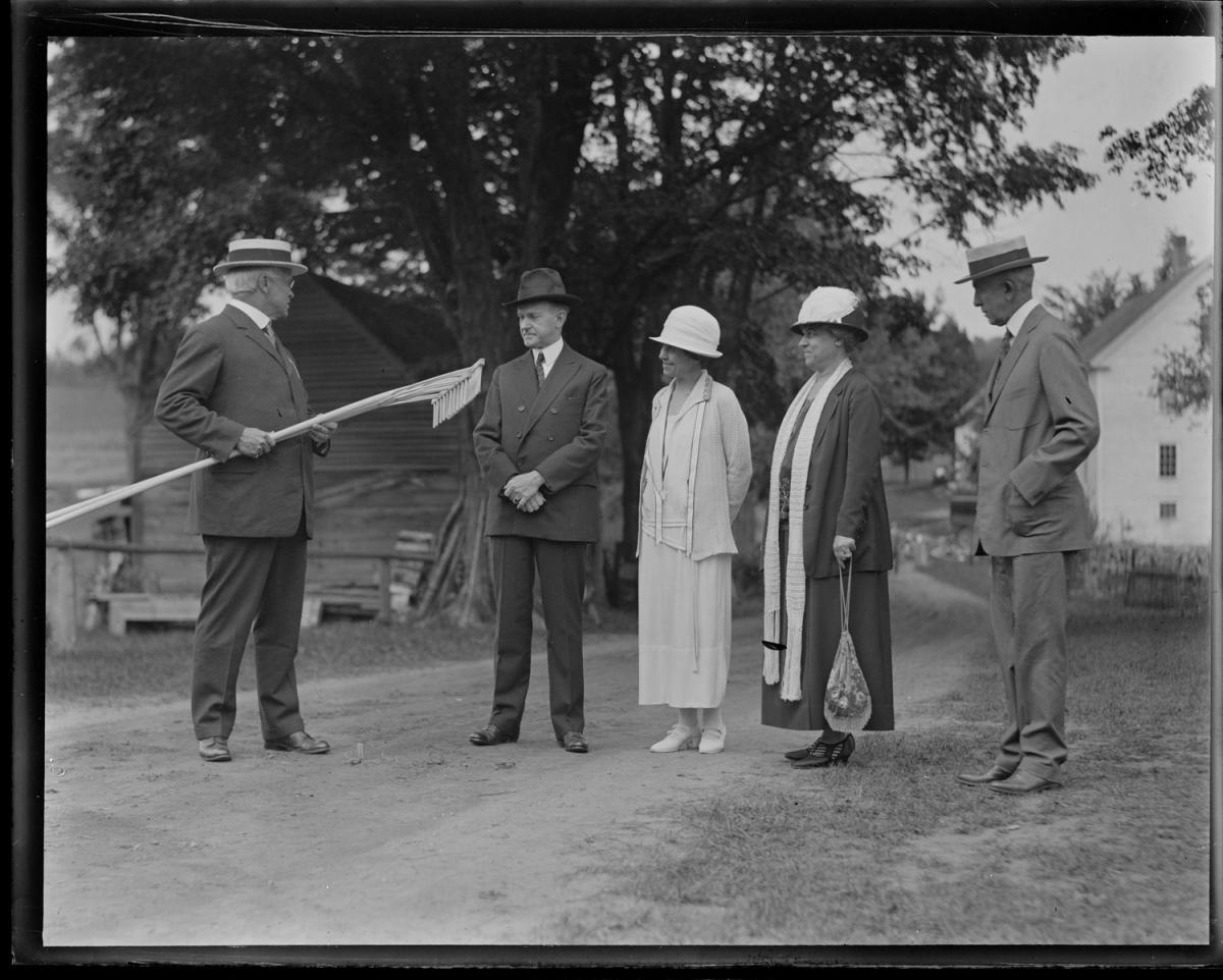 In August 1924, the Coolidges were comforted by the visit of long-time friendly faces from the days when both served in the Massachusetts General Court, Colonel and Mrs. Treadway. Now representing the first congressional district of their state, Colonel Treadway presents the gift of two custom-crafted hay rakes for the President to use on the Homestead.