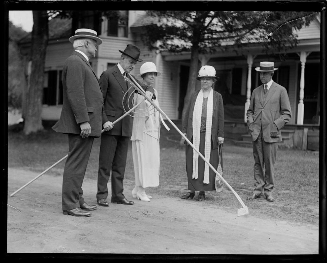 President Coolidge examines the quality of the craftsmanship.