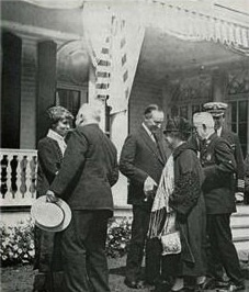 The Coolidges greeting visitors to the summer White House at White Court, where Executive business kept going throughout the summer,1926.