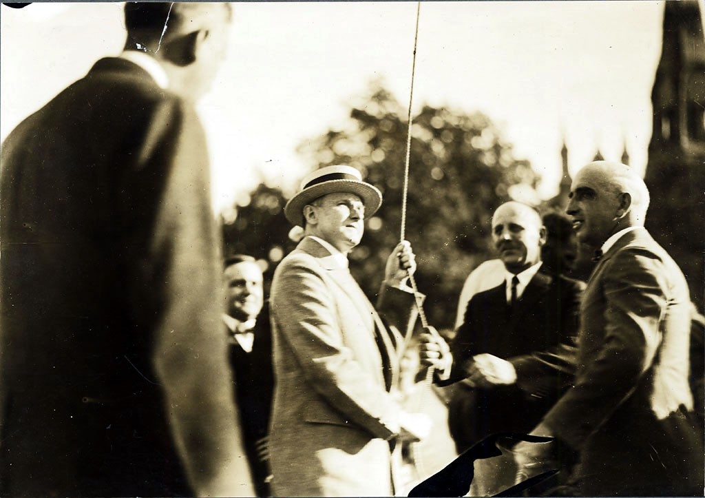 President Coolidge raises the flag over the Common at Lynn, Massachusetts, August 27, 1925.