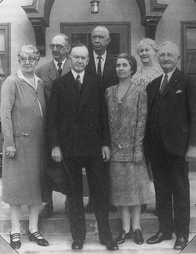 Former President Coolidge with Mrs. Coolidge, joined by the owners, operators and designers of Lakeside Inn in the 1930s. L to R: Mrs. F. W. Wentworth, architect Fred W. Wentworth, the Coolidges, Archie Hurlburt, manager of Lakeside, and Mr. and Mrs. Charles Edgerton. The Coolidges stayed in Mount Dora at the Inn from January to February 1930.