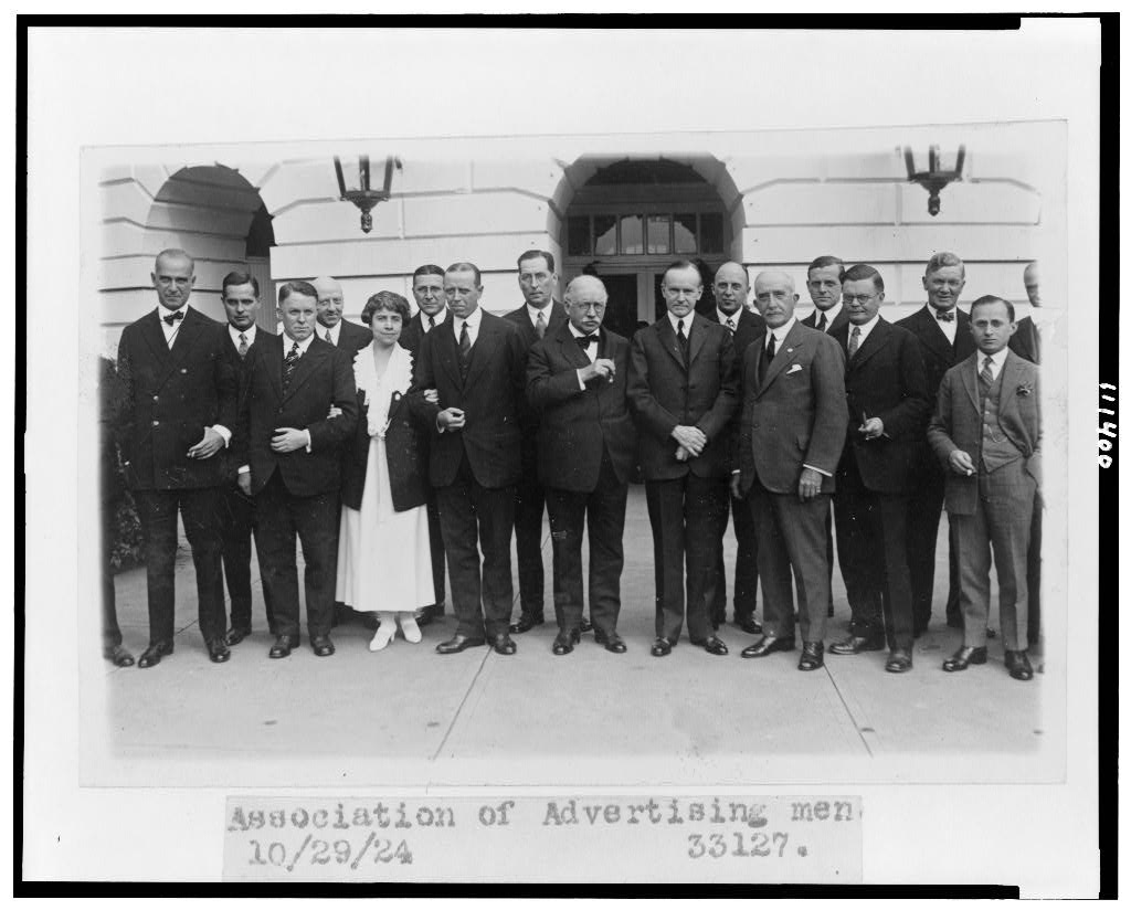 President Coolidge and the First Lady have their picture taken with members of the Advertising Association in 1924, two years before the speech cited below. Courtesy of the Library of Congress.