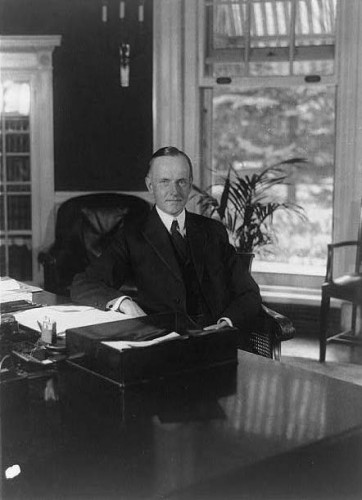 President Coolidge at his desk in the Executive Offices, August 15, 1923.