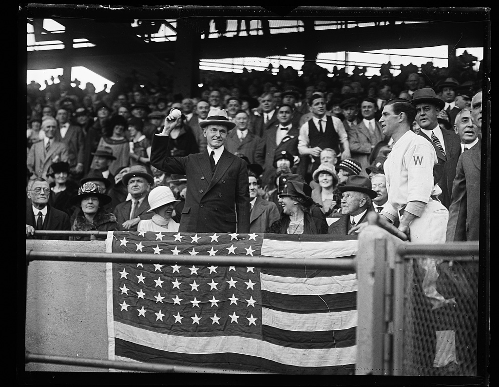 President Coolidge throwing out the first pitch, Griffith Stadium, as the Senators host the Giants, October 1924. Courtesy of the Library of Congress.