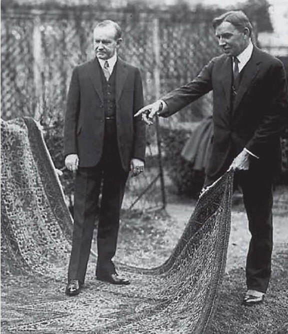 President Coolidge and Dr. Finley admiring the beautiful rug hand-made by the orphans rescued by the Kunzlers, White House lawn, 1925.