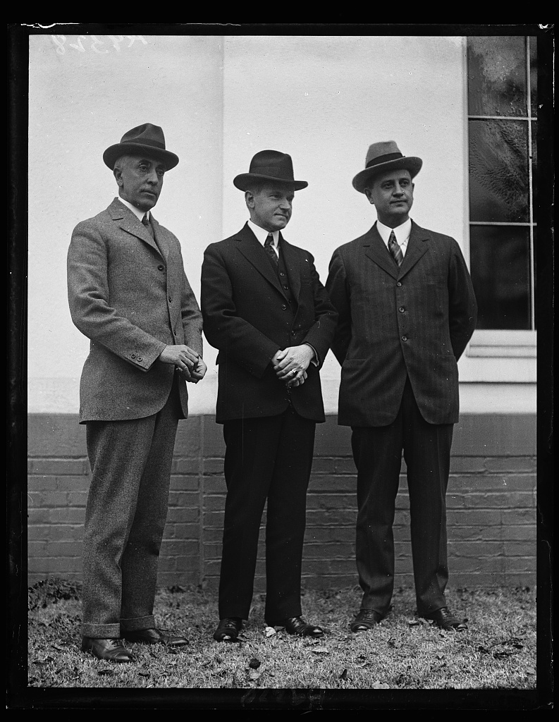 The President with outgoing secretary C. Bascom Slemp and incoming Everett Sanders, January 19, 1925, outside the Executive Offices.
