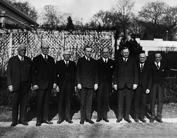 Members of the Pan American Conference to assemble in Havana, standing here on the grounds of the White House. L to R, they are: Judge Morgan J. O'Brien, New York; Charles Evans Hughes; Secretary of State Kellogg; President Coolidge; Henry P. Fletcher, American Ambassador to Italy; former Senator Oscar W. Underwood; Dr. James Scott Brown, Washington; and Dr. L. S. Rowe of the Pan American Union.