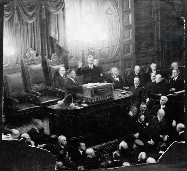 AQS254834 Calvin Coolidge (1873-1933) taking the oath of office as Governor of the State Senate, 1st January 1919 (b/w photo) by American Photographer, (20th century); American Antiquarian Society, Worcester, Massachusetts, USA; (add.info.: 30th President of the United States (1923-29);); American, it is possible that some works by this artist may be protected by third party rights in some territories