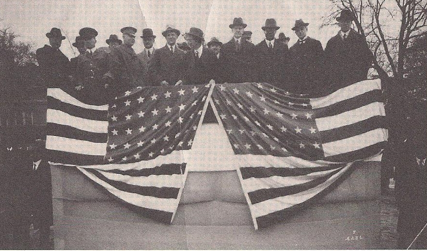 Gathering at the dedication of the hospital for veterans at Tuskegee, 1923. Then-Vice President Coolidge stands center above the flag to the right, to his left is Dr. Robert R. Moton, President of Tuskegee. Photo courtesy of Dan T. Williams, Archivist at Tuskegee University.