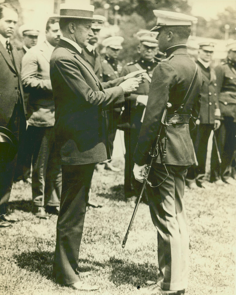 President Coolidge bestowing the Medal of Honor upon Lieutenant Christian Schilt for his actions under fire in Quilali, Nicaragua, six months before.