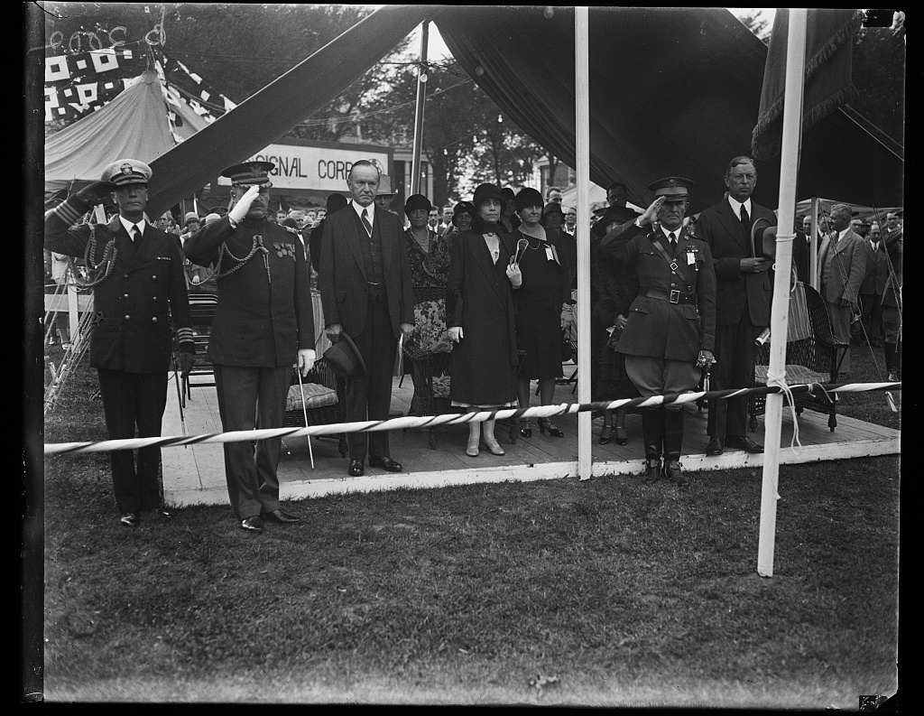 The Coolidges at a public ceremony, 1928.