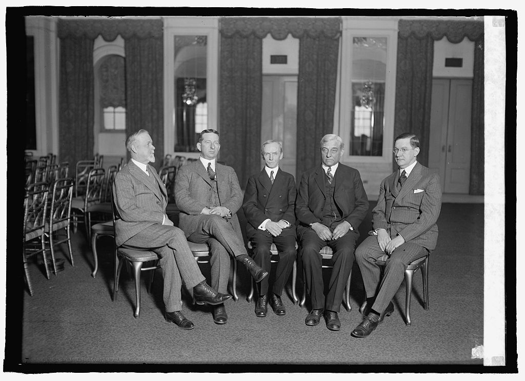 The officers of the American Society of Newspaper Editors taken at the Willard, January 16, 1925. Courtesy of the Library of Congress. Caspar S. Yost of the Globe-Democrat, President of the Association, sits in the center chair. Coolidge would speak to the entire assembly the following day.