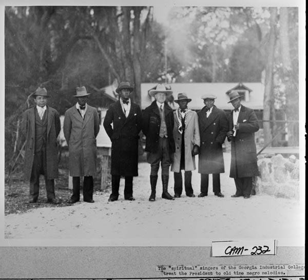 President Coolidge with the Singers of Georgia Industrial College, at Cabin Bluff, Georgia, December 1928.