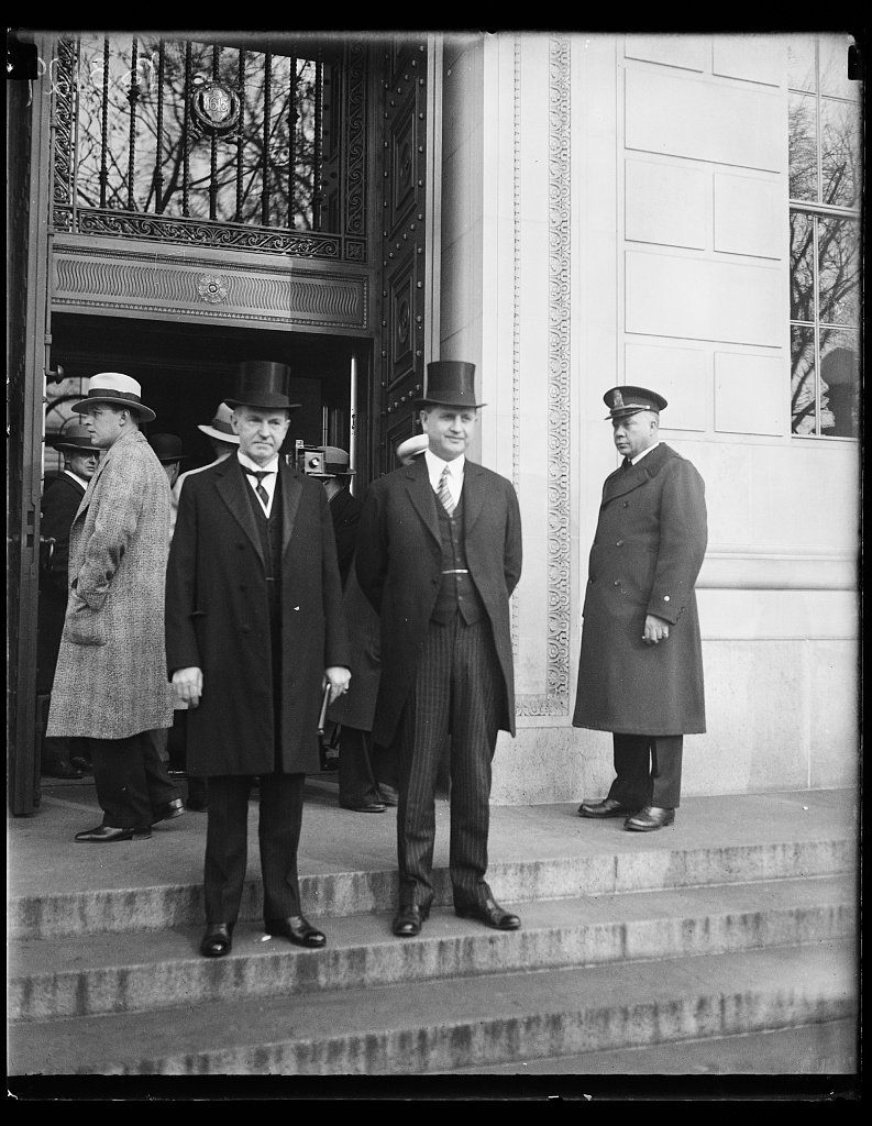 President Coolidge and his official secretary, Everett Sanders, outside the gathering of the Pan-American Conference on Arbitration and Conciliation, December 12, 1928. Courtesy of the Library of Congress.