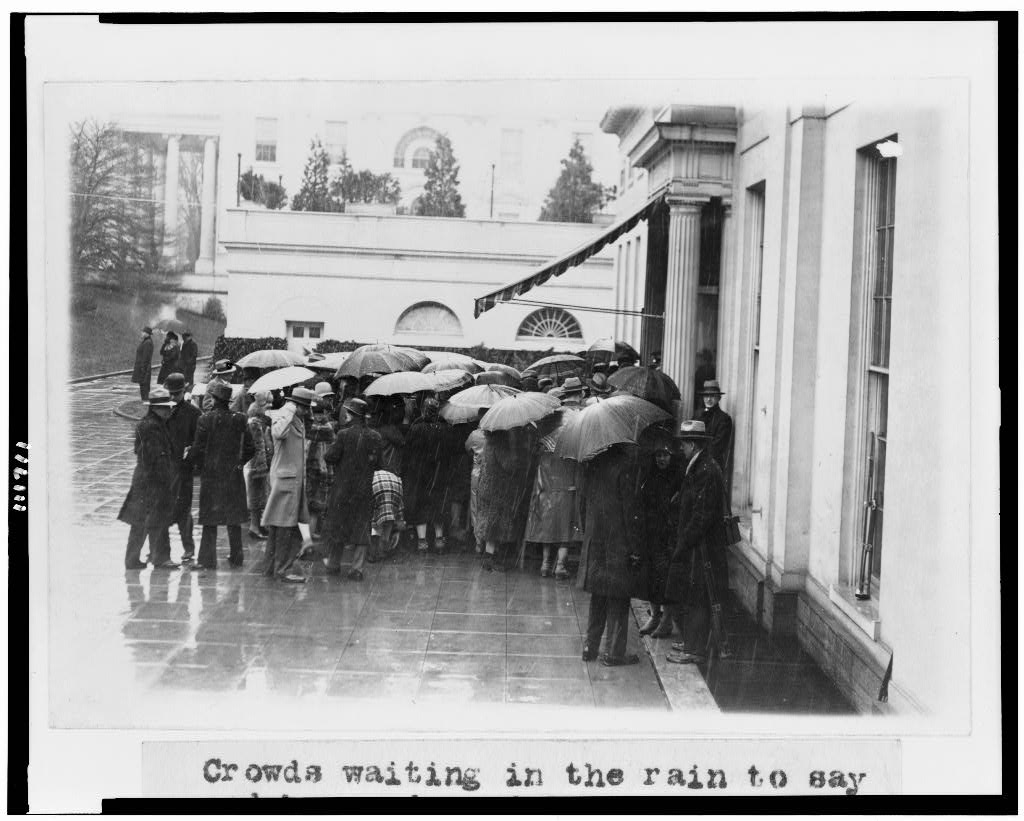 Crowds waiting in the rain to say goodbye and good luck to President Coolidge outside the White House 3-2-1929