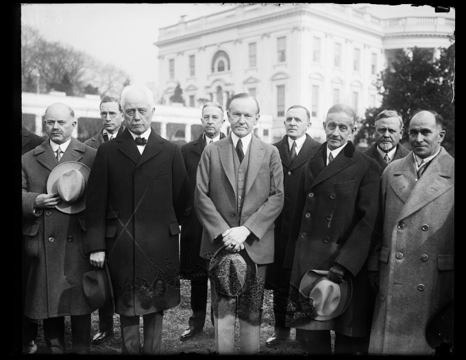 In the center of the photograph left to right Secretary of Commerce Whiting President Coolidge and George R. Putnam Commissioner of Lighthouses 1-17-1929