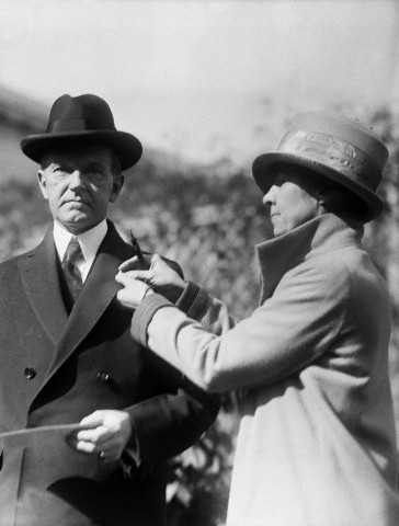 Calvin Coolidge Being Pinned by His Wife