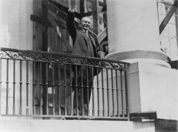 Photograph of President Coolidge waving a greeting to the throngs of children gathered in the White House grounds to roll Easter eggs, April 18th 1927.