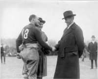 Frederick S. Bale introducing Benny Boynton, captain of the Williams College team, to Vice-President-Elect Calvin Coolidge before the Amherst-Williams game, won by Amherst 14-7. [Original in Morrow Papers, Series XIV, box 1, folder 100]