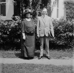 28 Jun 1924, Washington, DC, USA --- Original caption: Photo shows Mrs. Harriet Taylor Upton of Warren, Ohio, with President Calvin Coolidge on the lawn of the White House. Mrs. Harriet Taylor Upton has her hat in the ring for a seat in Congress, from the 19th District of Ohio, this fall and is now visiting in the nation's capital. President Coolidge escorted her about the White House grounds to view the beautiful roses now in bloom. --- Image by © Bettmann/CORBIS