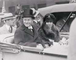 ca. 1925, Pittsburgh, Pennsylvania, USA --- Original caption: Cal Springs the Coolidge Smile for Pittsburgh's Natives. Pittsburgh, Pennsylvania: President and Mrs. Coolidge smile their greetings to the natives of Pittsburgh, Pa., as they parade through the streets as they arrived for the thirty-first Founders' Day celebration at Carnegie Institute. The president made the principal address. --- Image by © Bettmann/CORBIS