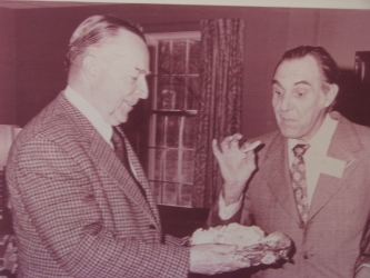John Coolidge, the President's son, offering samples of his cheese to a visiting Swiss delegation.