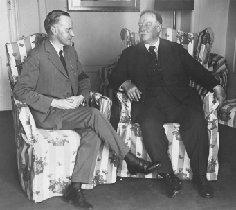New President Calvin Coolidge sits with predecessor, William H. Taft at the New Willard Hotel, 1923.
