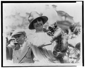 Mrs. Coolidge exhibits her pet raccoon [Rebecca] to crowds of children gathered for Easter egg rolling 4-18-1927