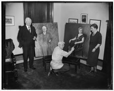The artist later in life displaying his portraits of Vice President and Mrs. Garner.