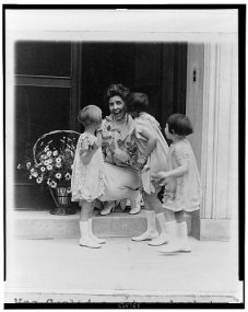 1927 April 30 Nan Norton - Elizabeth Ann Taylor, and Margaret Cooley present Mrs. Coolidge with basket of flowers as part of ceremonies for May Day is child health day.