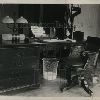 One of Coolidge's regular habits when kept at his desk for long stretches of time was removing his shoes and placing his feet in the most comfortable place he could think of...inside the waste paper basket. It appears the photographer caught the placement of the bin even in the President's absence. Photo credit: HistoricImages.
