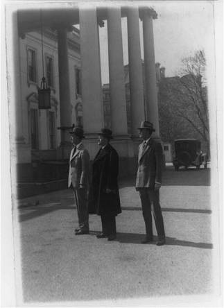 President Coolidge inspecting work being done at the White House. Col E. Sterling, Pres. Coolidge and Col. Cheney, military aide to the president 3-10-1927