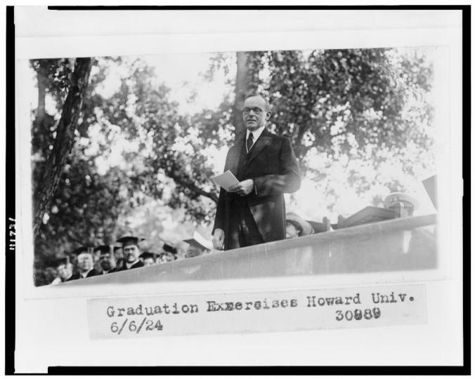 President Coolidge, half-length portrait, standing, facing slightly left, speaking at graduation exercises at Howard University 6-6-1924